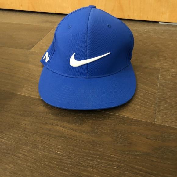 Nike golf hat never worn. M 5b9029795fef379cd8cb35e6 a23d776374b9